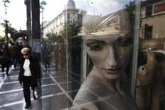 "A woman walks past mannequins in a closed shop at central Athens November 15, 2012. Thousands of small shops and businesses have closed up over the past few years of Europe's economic downturn, especially in the so-called ""PIIGS"" countries of Portugal, Italy, Ireland, Greece and Spain. REUTERS/John Kolesidis (GREECE - Tags: POLITICS BUSINESS TPX IMAGES OF THE DAY)"