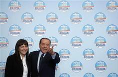 Il governatore del Lazio Renata Polverini con Silvio Berlusconi. REUTERS/Alessia Pierdomenico