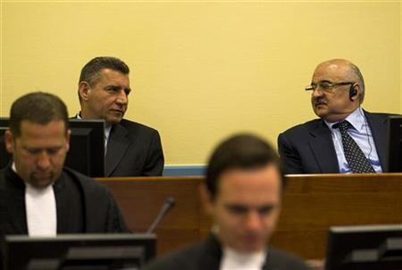Former Croatian Army General Ante Gotovina (L) talks to Ivan Cermak in the court room before the International Criminal Tribunal for the former Yugoslavia (ICTY) in The Hague, April 15, 2011. REUTERS/Jerry Lampen/Files
