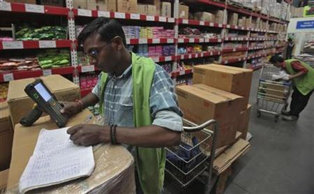 A worker tallies the stock at a Bharti Wal-Mart Best Price Modern wholesale store at Zirakpur in Punjab November 16, 2012. REUTERS/Ajay Verma