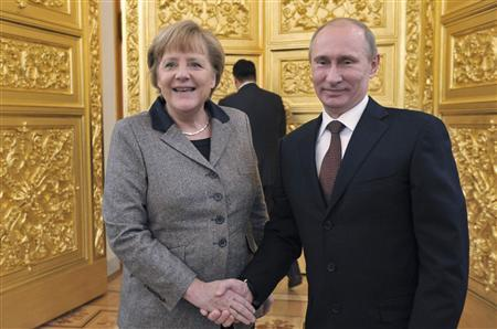 Russian President Vladimir Putin (R) shakes hands with German Chancellor Angela Merkel during their meeting in Moscow's Kremlin November 16, 2012. REUTERS/Alexei Nikolsky/RIA Novosti/Pool