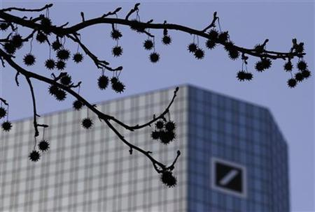 The logo of Germany's largest business bank, Deutsche Bank, is seen at the bank's headquarters behind twigs in Frankfurt January 31, 2012. REUTERS/Kai Pfaffenbach (GERMANY - Tags: BUSINESS LOGO)