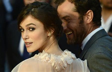 Actors Keira Knightley (L) and Jude Law pose for photographers as they arrive for the world premiere of ''Anna Karenina'' at the Odeon Leicester Square in central London September 4, 2012. REUTERS/Dylan Martinez/Files