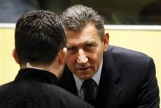 Ante Gotovina (R), who was commander in the Split district of the Croatian army, talks in the courtroom of the International Criminal Tribunal for the former Yugoslavia (ICTY) before his appeal judgement in The Hague November 16, 2012. REUTERS/Bas Czerwinski/Pool (NETHERLANDS - Tags: CRIME LAW CONFLICT POLITICS)