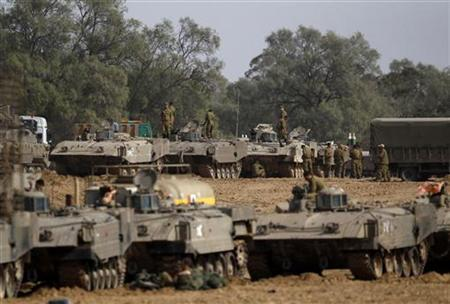 Israeli soldiers prepare armoured personnel carriers (APC) at an area near the border with the Gaza Strip November 16, 2012. REUTERS/Ronen Zvulun