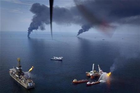 Oil is burned off the surface of the water near the source of the Deepwater Horizon spill in the Gulf of Mexico off the coast of Louisiana June 19, 2010. Propellers from the airplane are visible in the photo. REUTERS/Lee Celano