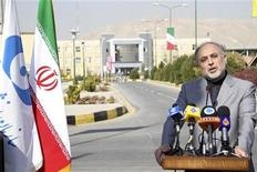 EDITORS' NOTE: Reuters and other foreign media are subject to Iranian restrictions on their ability to film or take pictures in Tehran. Chief of Iran's Atomic Energy Organization Ali-Akbar Salehi makes a speech during a ceremony to take delivery of locally produced yellowcake, a uranium concentrate powder, at the UCF plant in Isfahan 414 kilometres (257 miles) south of Tehran December 5, 2010. REUTERS/HO/Fars News (IRAN)