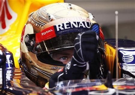 Red Bull Formula One driver Sebastian Vettel of Germany sits in his car during the first practice session of the U.S. F1 Grand Prix at the Circuit of the Americas in Austin, Texas November 16, 2012. REUTERS/Jim Young