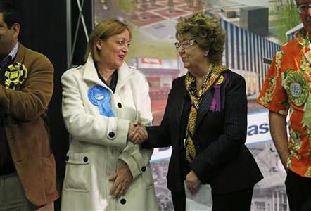 Britain's ruling Conservative Party candidate Christine Emmett (L) congratulates UKIP candidate Margot Parker after the by-election count in Corby, central England November 16, 2012. REUTERS/Eddie Keogh