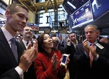 Selina Lo (C), President and CEO of of Ruckus Wireless, applauds as her company's stock begins trading on the floor of the New York Stock Exchange, November 16, 2012. WiFi products maker Ruckus Wireless Inc. priced its initial public offering at $15 per share, the high end of its expected price range, a market source told Reuters. The company, which is backed by Google Inc's Motorola Mobility LLC and venture capital firm Sequoia Capital, raised $126 million by selling 8.4 million shares. REUTERS/Brendan McDermid