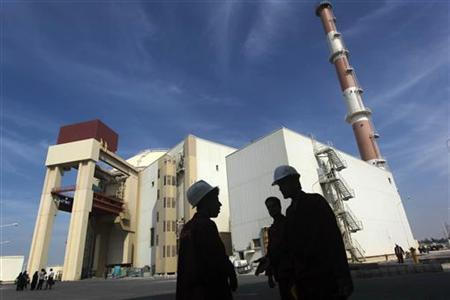 Iranian workers stand in front of the Bushehr nuclear power plant, about 1,200 km (746 miles) south of Tehran October 26, 2010. REUTERS/Mehr News Agency/Majid Asgaripour/Files