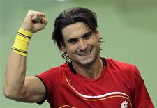 Spain's David Ferrer celebrates after winning over Czech Republic's Radek Stepanek during their Davis Cup tennis tournament final match in Prague November 16, 2012. REUTERS/David W Cerny