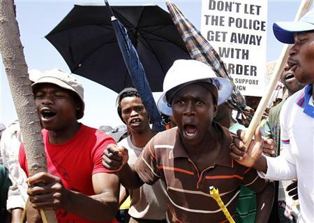 Striking miners sing during a strike at the AngloGold Ashanti mine in Carletonville, northwest of Johannesburg October 19, 2012. REUTERS/Siphiwe Sibeko