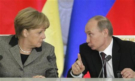 Russian President Vladimir Putin (R) and German Chancellor Angela Merkel answer journalists' questions during a joint news conference in Moscow's Kremlin November 16, 2012. REUTERS/Maxim Shemetov