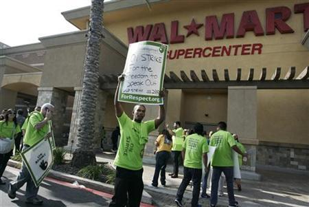 Striking Walmart workers walk a picket line during a protest over unsafe working conditions and poor wages outside a Walmart store in Pico Rivera, California, October 4, 2012. REUTERS/Jonathan Alcorn