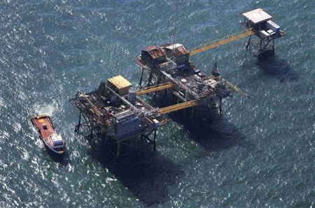 Rescue crew surrounds an oil platform which exploded early this morning in the Gulf of Mexico, off the coast of Louisiana, November 16, 2012. An oil platform in the Gulf of Mexico operated by Houston-based Black Elk Energy burst into flames on Friday, leaving at least two people missing and badly injuring several others, U.S. and Louisiana officials said. The fire has been extinguished, Black Elk spokeswoman Leslie Hoffman said. She said an emergency response is under way, but declined further comment, saying the company will issue a statement later Friday. REUTERS/Sean Gardner
