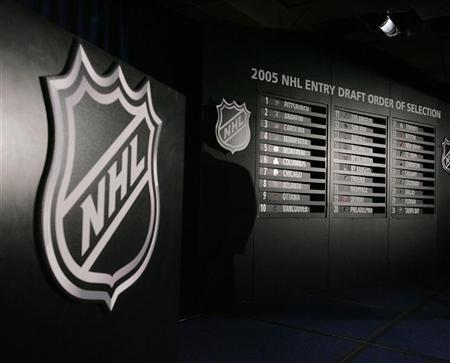 The results board at the National Hockey League (NHL) draft lottery is seen in New York July 22, 2005. REUTERS/Bruce Benentt/NHL/Pool