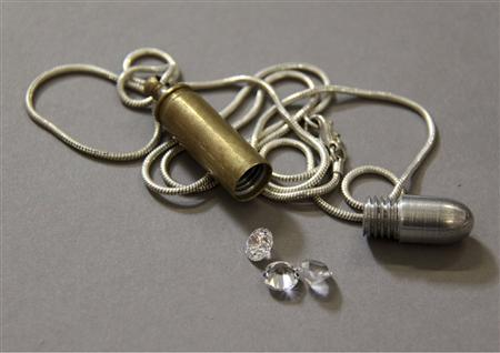 A bullet necklace that stores diamonds, from the James Bond 2002 film ''Die Another Day'' is pictured in this undated photograph released on November 16, 2012. The highly polished dental grade surgical steel alloy teeth are one of the artefacts featured in the exhibition ''Exquisitely Evil: 50 Years of Bond Villains,'' that opened at the International Spy Museum in downtown Washington on Friday. Reuters/1962-2012 Danjaq, LLC and United Artists Corporation/Handout