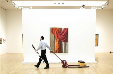 REFILE - ADDITIONAL CAPTION INFORMATION Workers put together the displays for the Sotheby's Latin American Art auction, in front of the artist Claudio Bravo's piece entitled 'Angelis', in New York November 16, 2012. The piece is expected to fetch between $900,000 to $1.2 million during the auction, to held on 19 and 20 November. REUTERS/Carlo Allegri