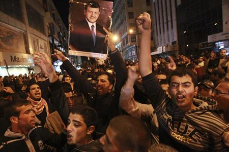 Regime loyalists shout slogans of support for Jordan's King Abdullah in Amman November 16, 2012. REUTERS/Muhammad Hamed