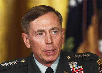 Then U.S. Army Gen. David Petraeus talks at an event in the East Room of the White House in this April 28, 2011 file photo during U.S. President Barack Obama's announcement that then CIA Director Leon Panetta would be nominated as Secretary of Defense. Former CIA Director Petraeus will testify November 16, 2012 on Capitol Hill about the recent attack on the U.S. diplomatic mission in Benghazi, Libya, but is also expected to be asked about his resignation last week over an extramarital affair. REUTERS/Larry Downing