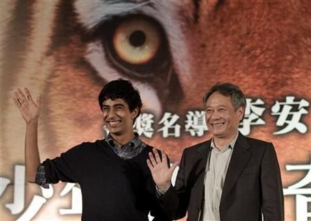 Taiwan-born director Ang Lee (R) and cast member Suraj Sharma of India wave during a news conference to promote their latest film ''The Life of Pi'' in Taipei November 7, 2012. REUTERS/Pichi Chuang