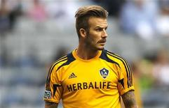 David Beckham of the L.A. Galaxy warms up before his team faces the Vancouver Whitecaps during their MLS soccer match in Vancouver, British Columbia July 18, 2012. REUTERS/Ben Nelms