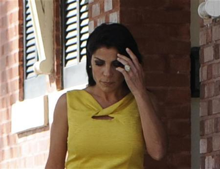 Jill Kelley, a friend of the Petraeus family, walks out of her home toward her car on Bayshore Boulevard in Tampa, Florida November 12, 2012. REUTERS/Brian Blanco