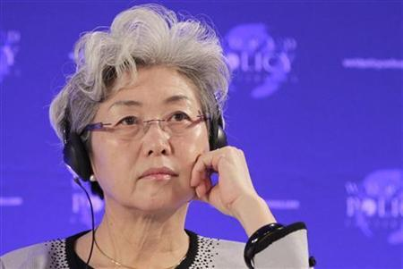 Fu Ying, China's Vice Foreign Minister, reacts as she attends a plenary session during the World Policy Conference at the historic Hofburg palace in Vienna December 10, 2011. REUTERS/Herwig Prammer/Files