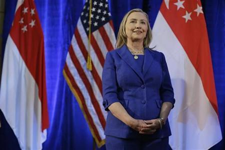 U. S. Secretary of State Hillary Clinton waits to speak as she is introduced at the Singapore Management University in Singapore November 17, 2012. REUTERS/Matt Rourke/Pool