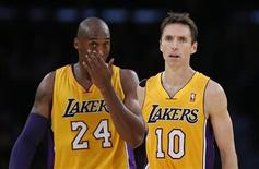 Los Angeles Lakers Steve Nash of Canada (R) and Kobe Bryant react during their loss to the Dallas Mavericks during their NBA basketball game in Los Angeles, October 30, 2012. REUTERS/Lucy Nicholson