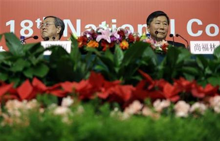China's Central Bank Governor Zhou Xiaochuan (L) and Chairman of China Banking Regulatory Commission Shang Fulin attend a news conference held on the sidelines of the18th National Congress of the Communist Party of China (CPC), in Beijing November 11, 2012. REUTERS/Jason Lee