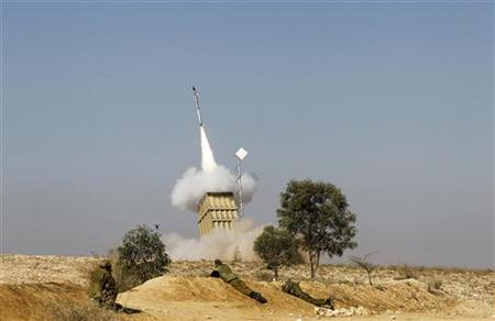 Israeli soldiers watch as an Iron Dome launcher fires an interceptor rocket near the southern city of Beersheba November 15, 2012. REUTERS/Baz Ratner