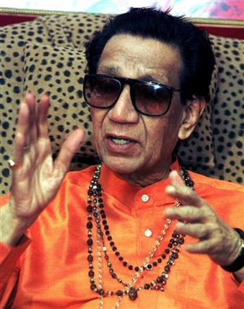 Bal Thackeray gestures during a news conference in Mumbai February 12, 2002. REUTERS/Stringer/Files
