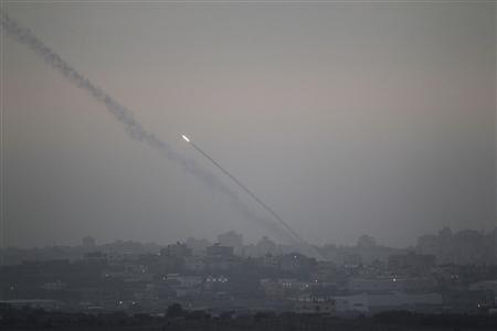 Smoke trails are seen as a rocket is launched from the northern Gaza Strip towards Israel November 17, 2012. Palestinian militants fired a rocket at Tel Aviv on Saturday but it was intercepted in mid-air by a newly deployed Israeli anti-missile battery and caused no casualties or damage, police said. REUTERS/Ronen Zvulun