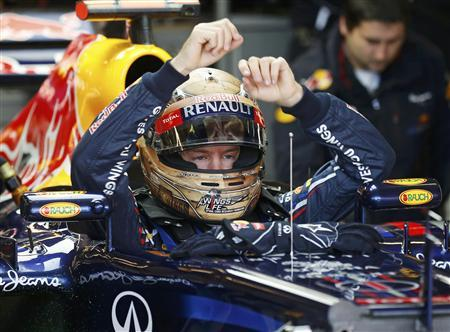 Red Bull Formula One driver Sebastian Vettel of Germany sits in his car during the third practice session of the U.S. F1 Grand Prix at the Circuit of the Americas in Austin, Texas November 17, 2012. REUTERS/Jim Young