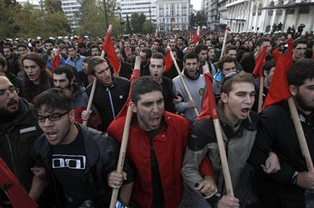 Greek students shout slogans during a rally marking the 39th anniversary of a 1973 student uprising against a U.S. backed dictatorship ruling Greece then in Athens November 17, 2012. Thousands of austerity-hit Greeks marched to the U.S. embassy to mark the bloody uprising against the military junta that ruled Greece. REUTERS/John Kolesidis