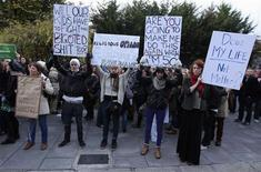 People participate in a vigil in Dublin November 17, 2012, in memory of Savita Halappanavar and in support of changes to abortion law. A wave of protests have taken place across Ireland in recent days in response to the death of 31-year old Halappanavar who died of septicaemia following a miscarriage 17 weeks into her pregnancy. REUTERS/Cathal McNaughton