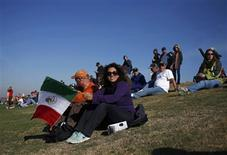 Fans of Sauber Formula One driver Sergio Perez of Mexico watch the third practice session of the U.S. F1 Grand Prix at the Circuit of the Americas in Austin, Texas November 17, 2012. REUTERS/Adrees Latif