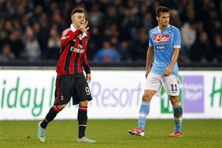 AC Milan's Stephan El Shaarawy (L) celebrates after scoring his second goal as Napoli's Christian Maggio watches during their Italian Serie A soccer match at the San Paolo stadium in Naples November 17, 2012. REUTERS/Giampiero Sposito