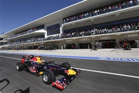 Red Bull Formula One driver Sebastian Vettel of Germany steers his car in the pit lane during the qualifying session of the U.S. F1 Grand Prix at the Circuit of the Americas in Austin, Texas November 17, 2012. REUTERS/Luca Bruno/Pool