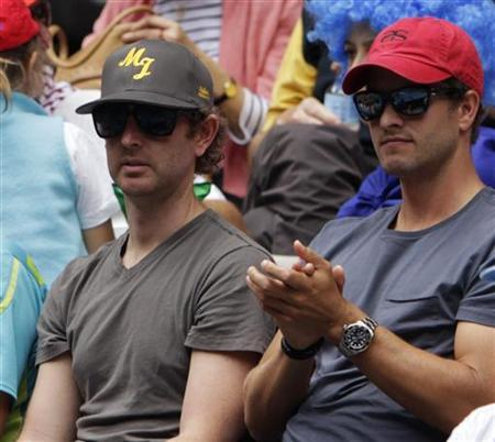 Australian golfer Adam Scott (R), boyfriend of Ana Ivanovic of Serbia, watches her women's singles match against Vania King of the U.S. at the Australian Open tennis tournament in Melbourne January 21, 2012. REUTERS/Darren Whiteside