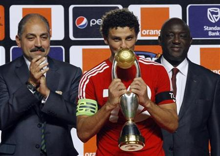 Egypt's Al Ahli's team captain Hossem el Sayed kisses a trophy after winning against Esperance de Tunis in their African Champions League (CAF) final soccer match in Rades Stadium in Tunis November 17, 2012. REUTERS/Anis Mili