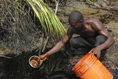 Nigeria Exxon spill spreads for miles along coast