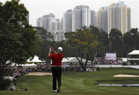 Miguel Angel Jimenez from Spain hits a shot on the 18th fairway during the final day of the Hong Kong Open Championship November 18, 2012. REUTERS/Tyrone Siu