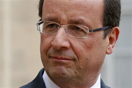 France's President Francois Hollande listens as a guest speaks in the courtyard following a meeting at the Elysee Palace in Paris, November 17, 2012. REUTERS/Benoit Tessier=