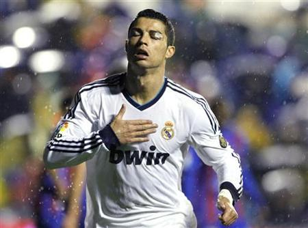 Real Madrid's Cristiano Ronaldo celebrates after he scored against Levante during their Spanish first division soccer match at the Ciudad de Valencia stadium in Valencia November 11, 2012. REUTERS/Heino Kalis