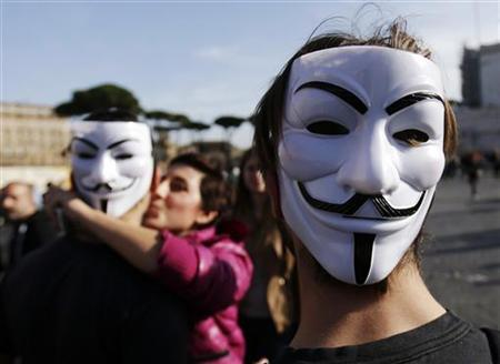 Students wear Guy Fawkes masks during a demonstration against austerity measures in downtown Rome November 14, 2012. REUTERS/Tony Gentile