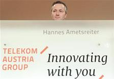 Telekom Austria Group CEO Hannes Ametsreiter reacts as he presents the annual business report for 2011 in Vienna February 23, 2012. Telekom Austria forecast 2012 sales and core profit may weather unrelenting price pressure and weak emerging Europe economies to nearly match 2011 levels that met market expectations. REUTERS/Herwig Prammer (AUSTRIA - Tags: BUSINESS TELECOMS)