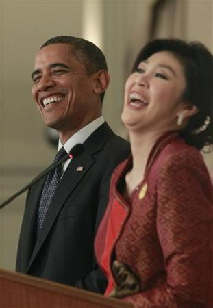 U.S. President Barack Obama and Thailand's Prime Minister Yingluck Shinawatra participate in a joint news conference at the Government House in Bangkok, November 18, 2012. Obama kicked off a three-country Asia tour with a visit to Thailand on Sunday, using his first post-election trek overseas to try to show he is serious about shifting the U.S. strategic focus eastwards. REUTERS/Jason Reed (THAILAND - Tags: POLITICS)
